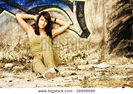 Young woman in casual clothing staring at camera.