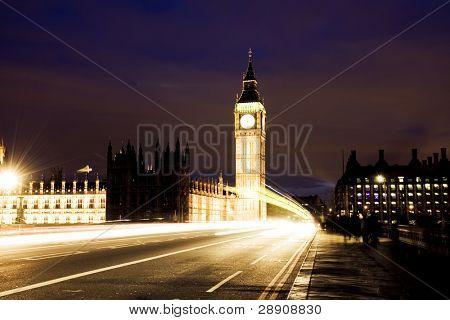 Nocturne scene with Big Ben behind light beams