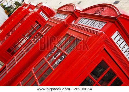 Five red phone boxes, angled composition