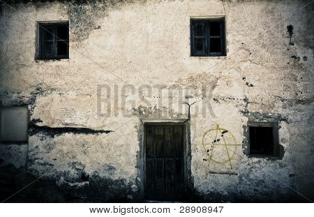 Old house facade, abandoned and grafted.