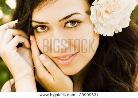 Beautiful young woman smiling at camera.