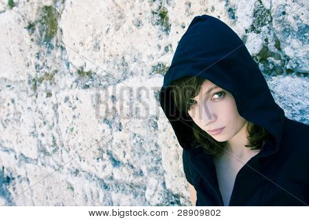 Young beautiful urban woman staring at camera