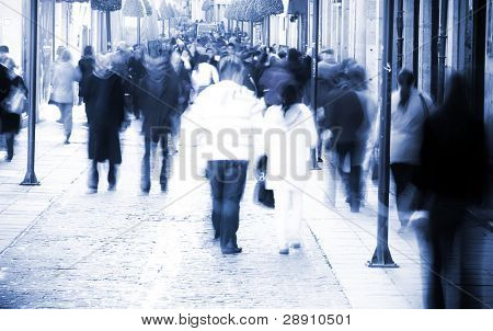 Blurred people in the middle of the street