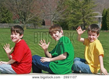Three Boys Waving