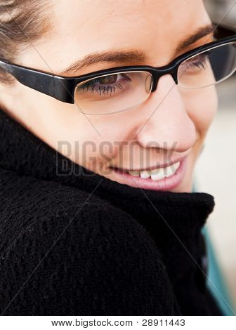 Young woman close portrait using glasses