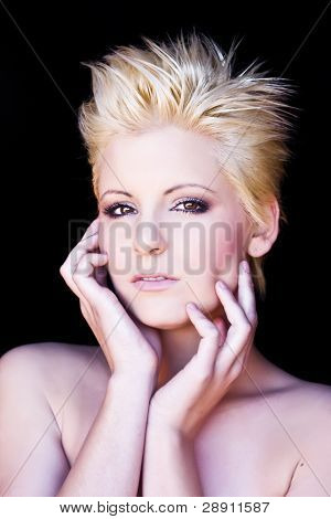 Young beautiful pensive blond isolated on black