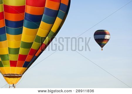 A pair of hot balloons in the air.