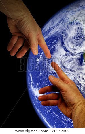 Two hands about to touch, portraying unity, peace for mankind, global cooperation.