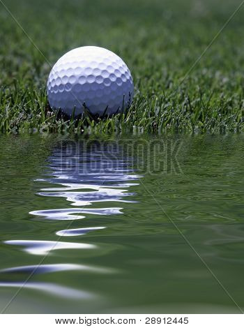 Water Hazard Golf Shot - A golf ball rests inches from the lake.