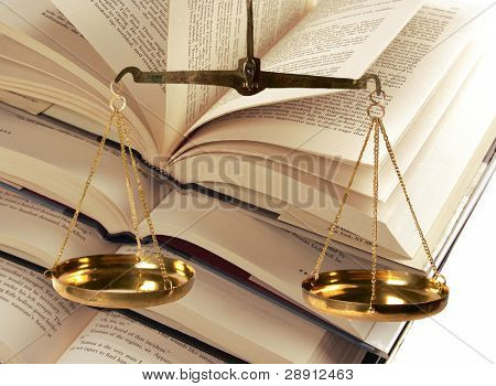 Scales Of Justice Atop Legal Books - Portrayal of Law and Judicial Branch of Government