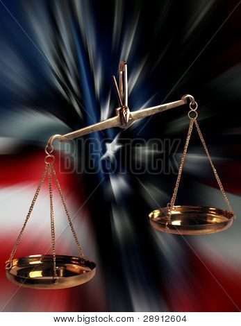 Scales Of Justice Over US Flag. Flag has rich colors and motion blur applied for interest.