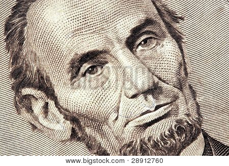Closeup of Abraham Lincoln on a US five dollar bill