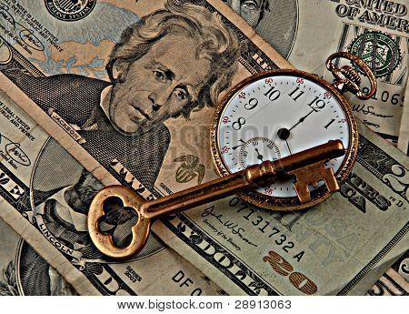 Time and money concept image. Skeleton key and pocket-watch. Purposefully high contrast