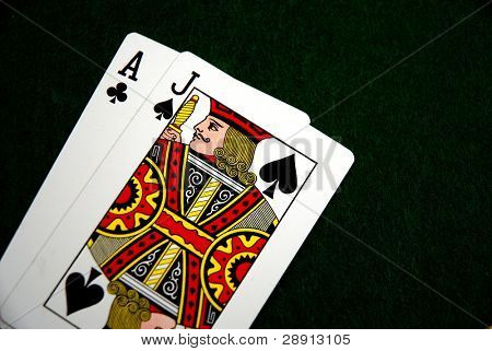 Blackjack - playing cards over green felt on a Vegas gambling table