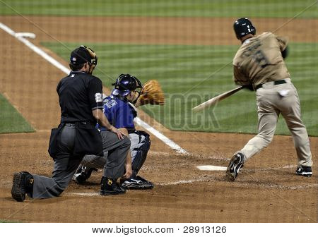 Jose Cruz Jr. of the San Diego Padres drives the ball during a game versus the Colorado Rockies at Petco Park