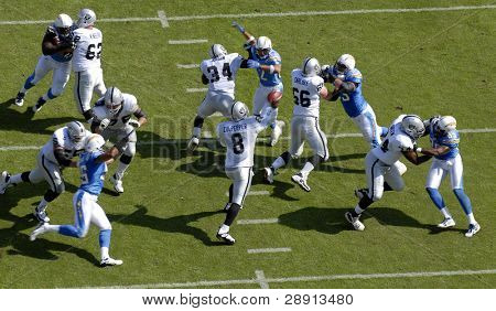 Oakland Raiders Quarterback Dante Culpepper steps back into the pocket and throws a pass. Includes Shawne Merriman and Shaun Phillips rushing the qb.