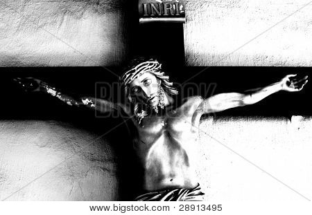Black and white abstract image of Jesus on the Cross. Image shot at Mission De Alcala in San Diego, California.
