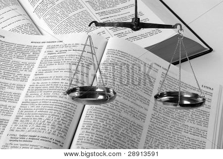 Scales and law books - black and white image with copy space left side