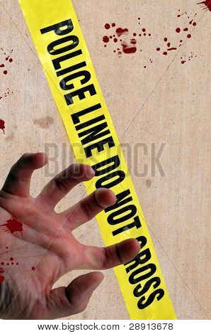 Crime Scene Investigation - police tape says 'police line do not cross' with a hand and blood.