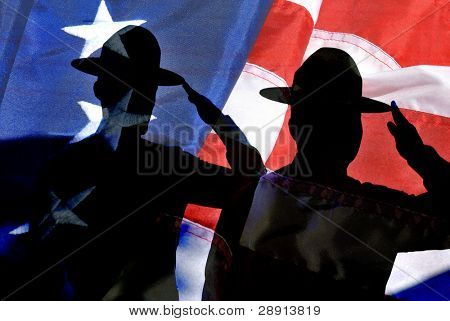 Silhouette of two Marines drill instructors saluting in composite with an old American Flag