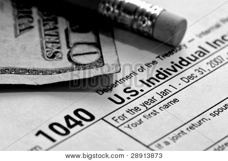 Tax Time - a pencil, US ten dollar bill, and federal 1040 tax form. Image is black and white.