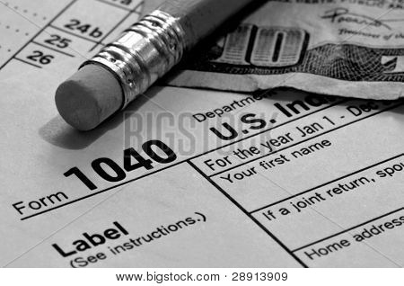 Tax Payments - a black and white concept image of a US 1040 tax form, a pencil and money.