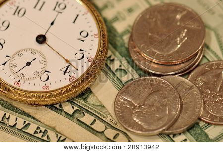 Time and money concept image - pocket watch and US currency.