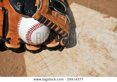 Time To Play Ball - baseball and glove on home plate.