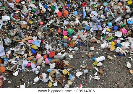 Recycling - pieces of smashed and broken garbage in a dump