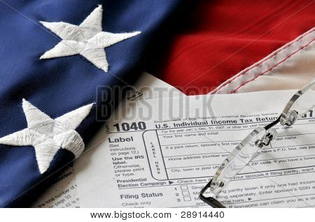 Tax Obligation - America's Red, White, And Blue, and US 1040 Individual Income tax form.