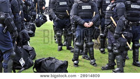 Riot Police - many officers in uniform preparing for duty