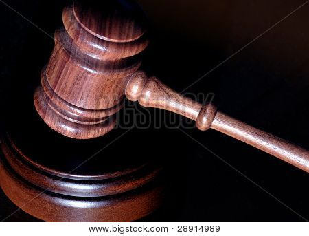 Judicial branch of government - gavel and practice of law with plenty of copy space. Image can be flipped horizontally as project requires.