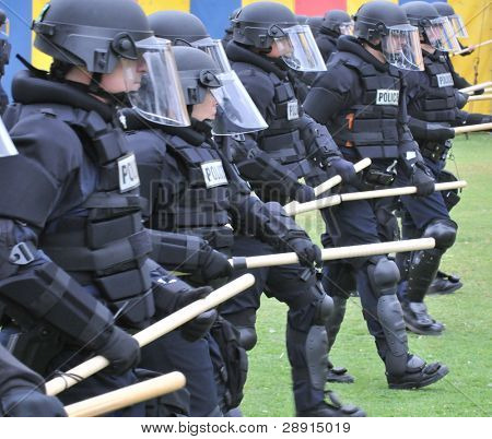 Preparing for civil unrest - Police officers in riot gear. Image taken on May 22nd at San Diego's Balboa Park during a SDPD tactical training exercise.