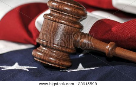 American Justice - wooden gavel and flag background.