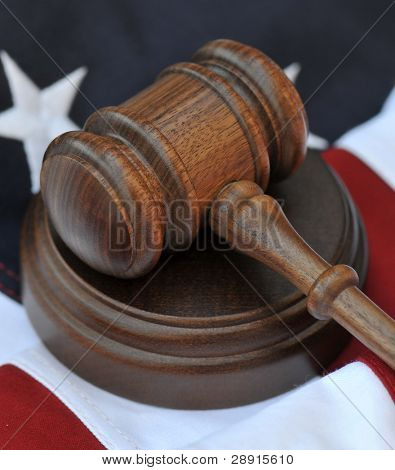 Judicial Decision-making - Gavel and American Flag background.
