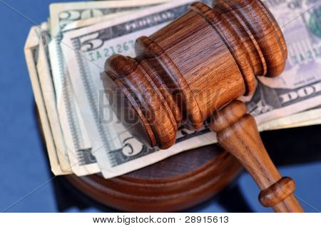Money Settlement by judgment - gavel atop currency.