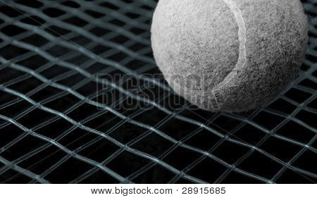 Game of Tennis - ball is black and white, with strings colored in electric blue hues and a deep black background.