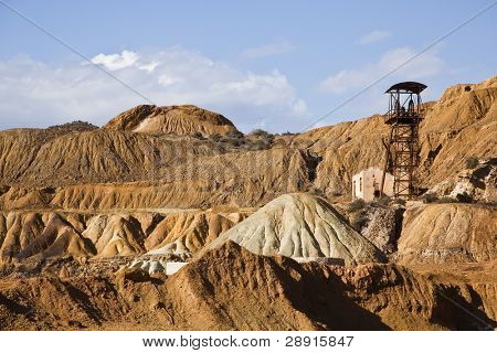 Abandoned old mining machinery in desert.