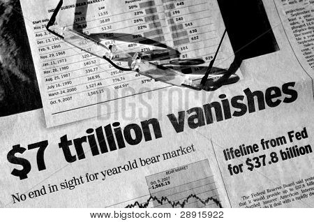Troubled days on wall street - black and white concept image of headlines and reading glasses. Headlines read: $7 Trillion Vanishes. No end in sight to year old bear market.