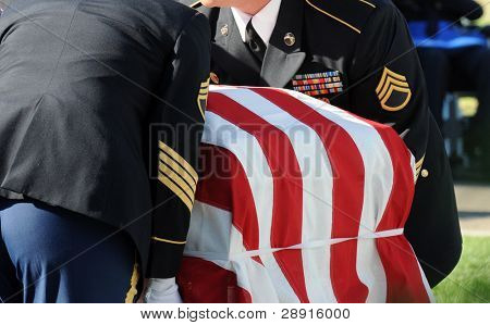 SAN DIEGO, CA - OCTOBER 29, 2008: Fort Rosecrans National Cemetery. Honor Guard carries a casket during a memorial ceremony to honor soldier and officer Federico Borjas.