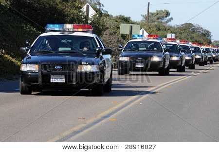 SAN DIEGO, CA - OCTOBER 29, 2008: Fort Rosecrans National Cemetery. A long line of police cars move toward a memorial ceremony to honor fallen soldier and officer Federico Borjas.