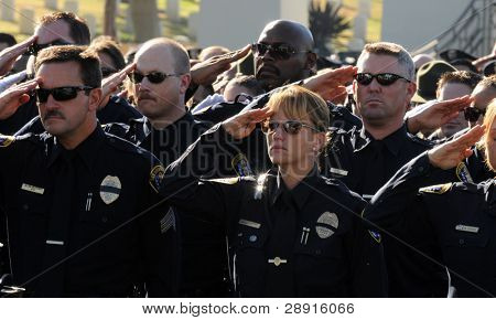 SAN DIEGO, CA - OCTOBER 29, 2008: Members of the San Diego Police Department salute during a ceremony for fallen PD Officer Federico Borjas.