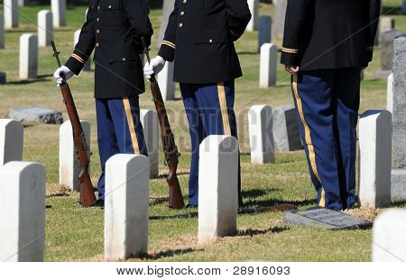Honoring The Fallen - Military Honor Guard among headstones at a national cemetery