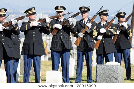 SAN DIEGO, CA - OCTOBER 29, 2008: Honoring The Fallen - Military Honor Guard among headstones at a ceremony for fallen soldier Federico Borjas.