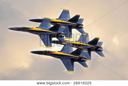 SAN DIEGO, CA - OCTOBER 4, 2008: MiraMar NAS AirShow. Closeup of four U.S. Navy Blue Angels F/A-18 Hornets flying in very tight formation during an airshow in San Diego, California