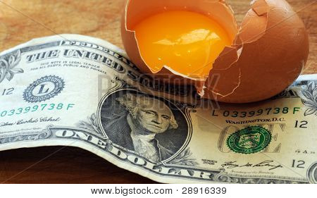 Broken Retirement NestEgg - concept image with cracked egg and currency.