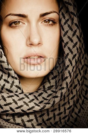 Arab woman using veil with her mouth pierced.