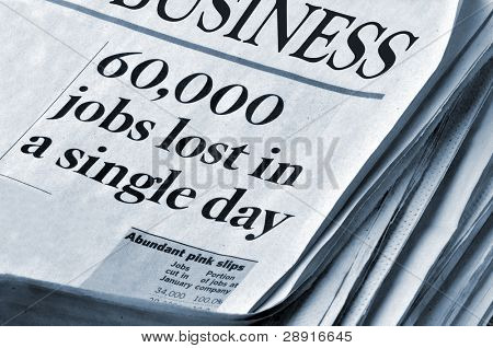 Layoffs and Recession Themes - business section of newspaper with headlines '60,000 jobs lost in a single day'. No paper identification.