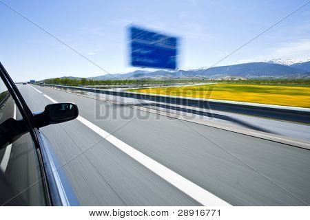 Driving at high speed under blue sky.