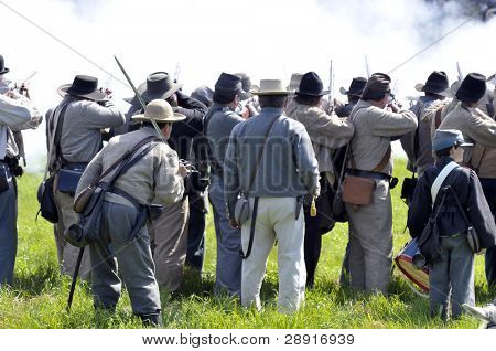 VISTA, CA - MAR 7: â??Confederateâ?? soldiers fire on the enemy during Civil War reenactment on March 7, 2009 in Vista. The yearly reenactment honors the Americans who died during the Civil War.